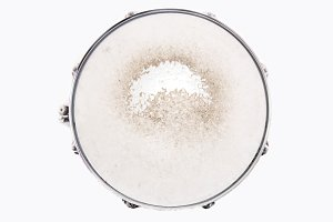 Snare drum over white. Music.