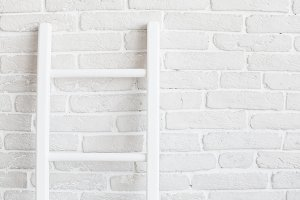 White brick wall with ladder