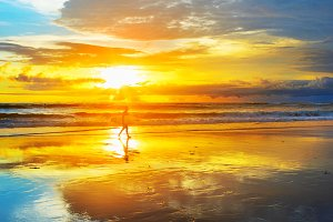 Surfer in sunbeams. Bali island