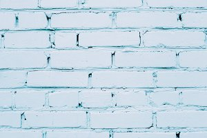 Blue cracked brick wall