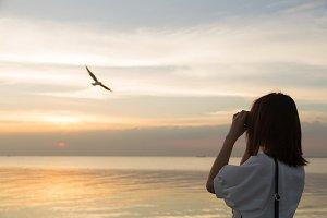 woman watching bird
