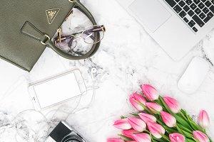 Office desk flat lay tulip flowers