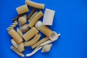 Traditional Italian pasta, blue background with copy space