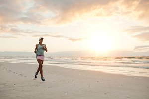 Fit woman running on the beach
