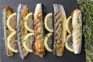 grilled fish saury with lemon