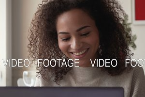 smiling african american young woman work using laptop