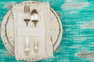 Tableware and silverware on the light blue background
