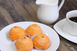 Orange Chinese pastry on wood table