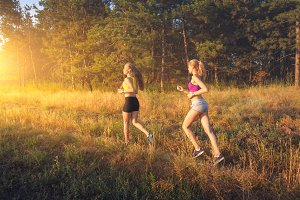 Sporty girls running on a field