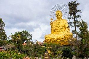 Statue of Big Golden Sitting Buddha in Dalat, Vietnam
