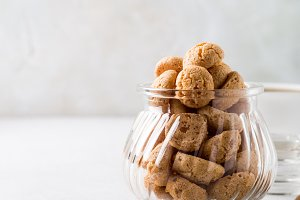 Amaretti cookies with white cup of coffee