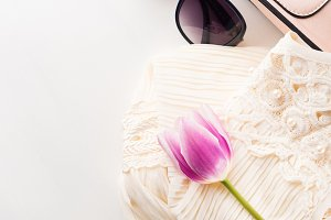 Woman clothes dress accessories fashion shopping on white