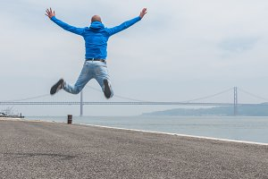 Young man jumping, Lisbon, Portugal