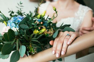 Beautiful bouquet of roses and bride's hand with ring