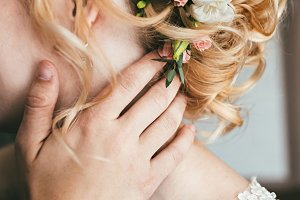 Pretty young bride with flowers in her hair