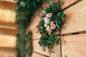 Romantic background with pink roses on wood planks