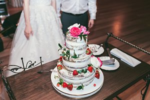 Wedding cake decorated with roses and strawberry