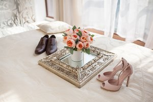 Wedding decorating bouquet with newlyweds shoes