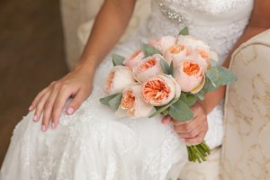 Bride holding rich marriage bouquet