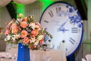 Gorgeous bouquet on guest table on wedding ceremony