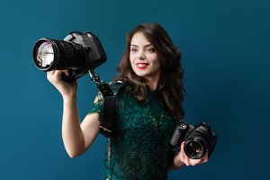 Woman holding two photographic cameras