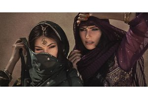 Arabian woman traveling in desert. Sandstorm effect not noise