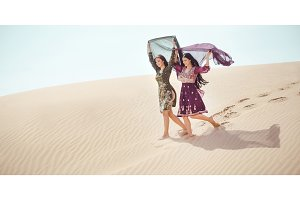 Women in desert landscape. Travel concept.