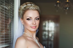 Gorgeous blonde bride in white dress