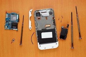 Broken smartphone on table