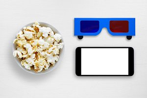 Popcorn, smartphone and 3d glasses