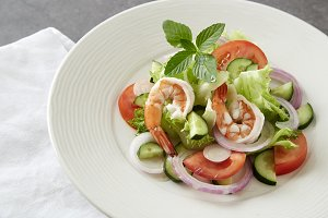 Salad of vegetables and boiled shrimp
