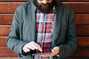 Handsome trendy man with tablet