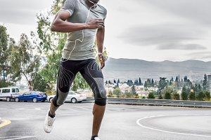 Black man running in the street