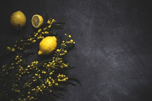 Fresh lemons on a black background
