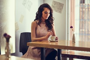 Young woman in coffee bar