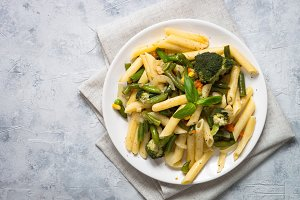 Italian vegetarian pasta penne with green vegetables.