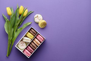 Yellow tulips and a box of macarons