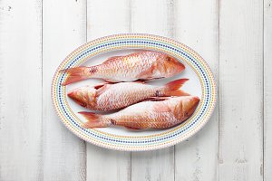 Red mullet fish on plate