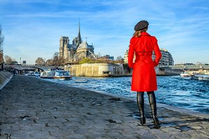 woman standing on embankment near Notre Dame de Paris