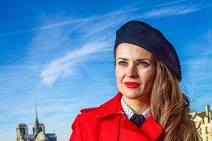 traveller woman on embankment in Paris looking into the distance