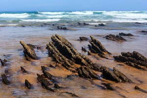 Rock formations on sandy beach