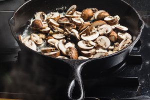 Sauteing mushrooms in skillet