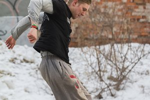 Parkour jumping in winter snow park - free-run training