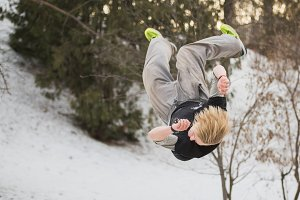 Backflip parkour jumping in winter snow park - free-run training