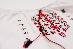 Detail Ukrainian ethnic ornament clothes