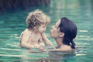 Baby having bath with mum