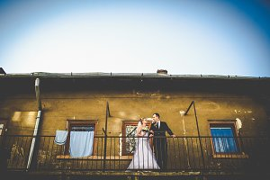 Bride and groom on the old balcony