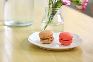 Macarons and flower on the table