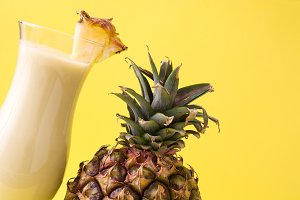 Piña colada cocktail and pineapple