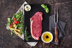 Raw steak with herbs